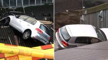 Lucky escape after Sydney motorist plunges six metres into factory roof