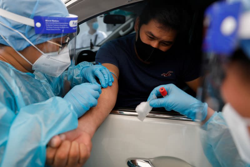 Philippine health ministry reports 2,995 new coronavirus infections, 60 more deaths