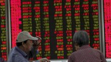 World shares mixed following Fed's decision to cut rates