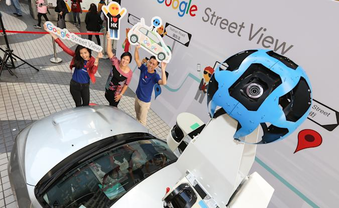 (L to R) Cynthia Wei, Google Asia Pacific Street View Program Manager; Leonie Valentine, Managing Director of Sales and Operations, Google Hong Kong; and Raf Ho, Google Street View Operation Specialist, pose for a photograph as Google Maps gets a refresh for Hong Kong with Street View Car in Causeway Bay. 28NOV16 SCMP/Felix Wong (Photo by Felix Wong/South China Morning Post via Getty Images)