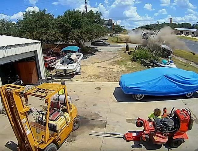 Ring camera captures out of control truck careening toward Texas body shop