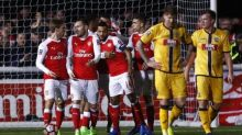 Ton up for Walcott as Arsenal end Sutton's dream Cup run