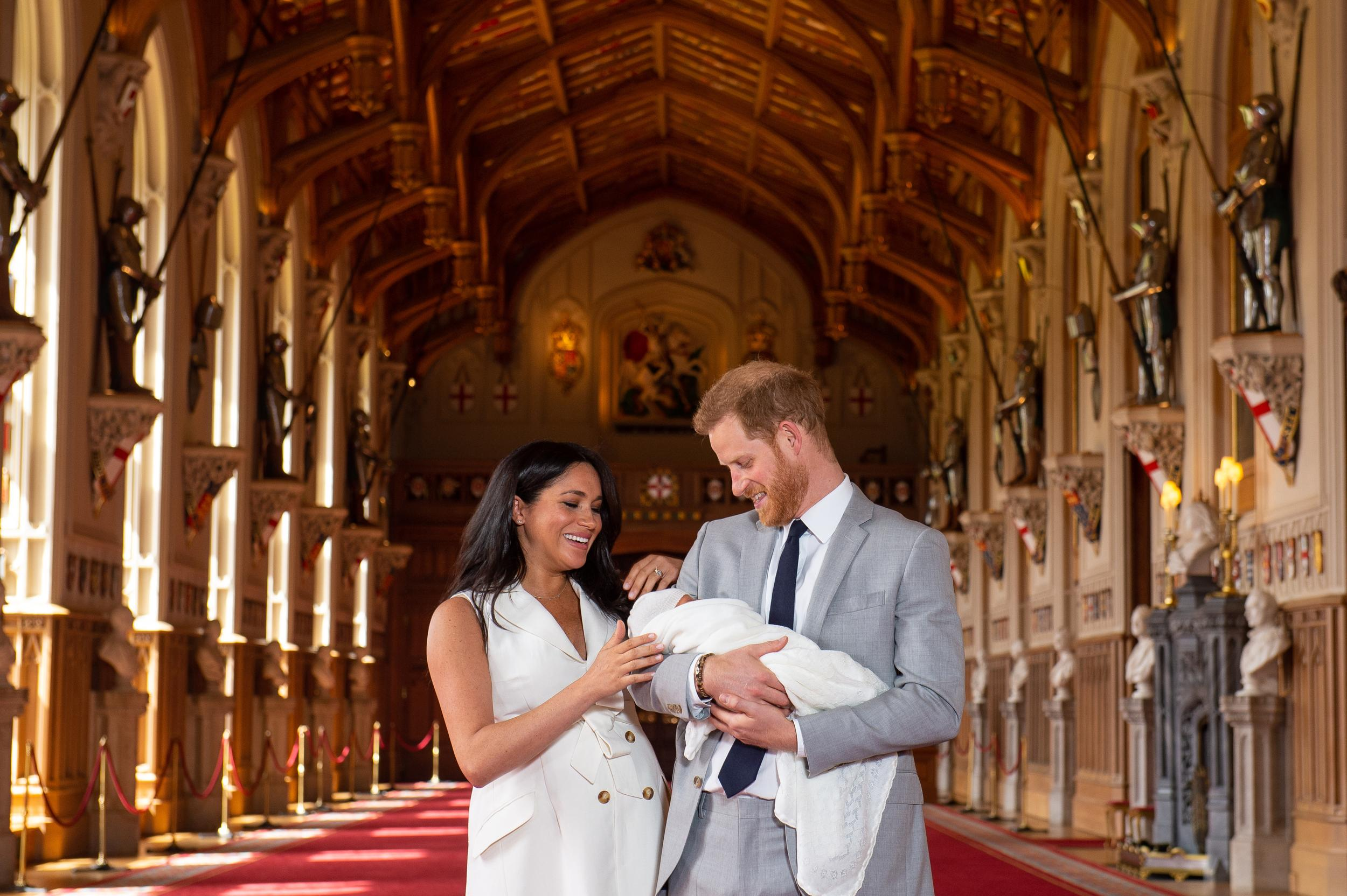 EMBARGOED to 1240 WEDNESDAY MAY 08 2019. The Duke and Duchess of Sussex with their baby son, who was born on Monday morning, during a photocall in St George's Hall at Windsor Castle in Berkshire.