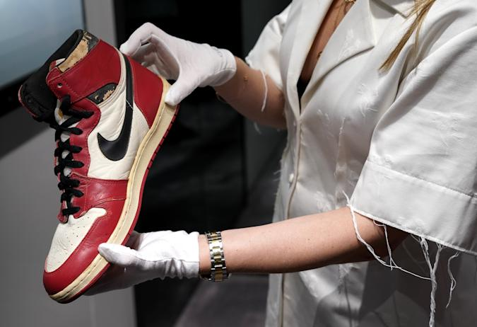 Caitlin Donovan Christies head of Sales, Handbags, and Accessories  holds the Air Jordan 1 High Shattered Backboard Origin Story, Game-Worn Signed Sneaker Nike, 1985 Size 13.5 High-Top on display during a press preview July 24, 2020 at Christie's New York. - Christies and Stadium Goods have partnered to offer a unique sneaker overview of Michael Jordans era-defining Chicago Bulls career. The auction  is online only 30 July13 August. (Photo by TIMOTHY A. CLARY / AFP) (Photo by TIMOTHY A. CLARY/AFP via Getty Images)