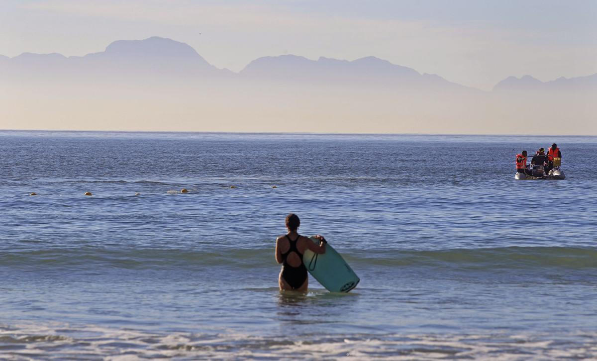 """<p>The number of fatal, unprovoked shark attacks in South African waters between1990-2009, is 22, according to the <a href=""""http://www.shark.co.za/"""">KwaZulu Natal Sharks Board</a>. There have been136 attacks in total.</p>  <p>In 2012, there were fourshark attacks in South Africa, three of them fatal, according to the International Shark Attack File.</p>  <p>Picture: A woman enters the water as workers aboard a boat, right, place a shark exclusion net at Fish Hoek beach, on the outskirts of Cape Town, South Africa, Friday, April 5, 2013.</p>"""