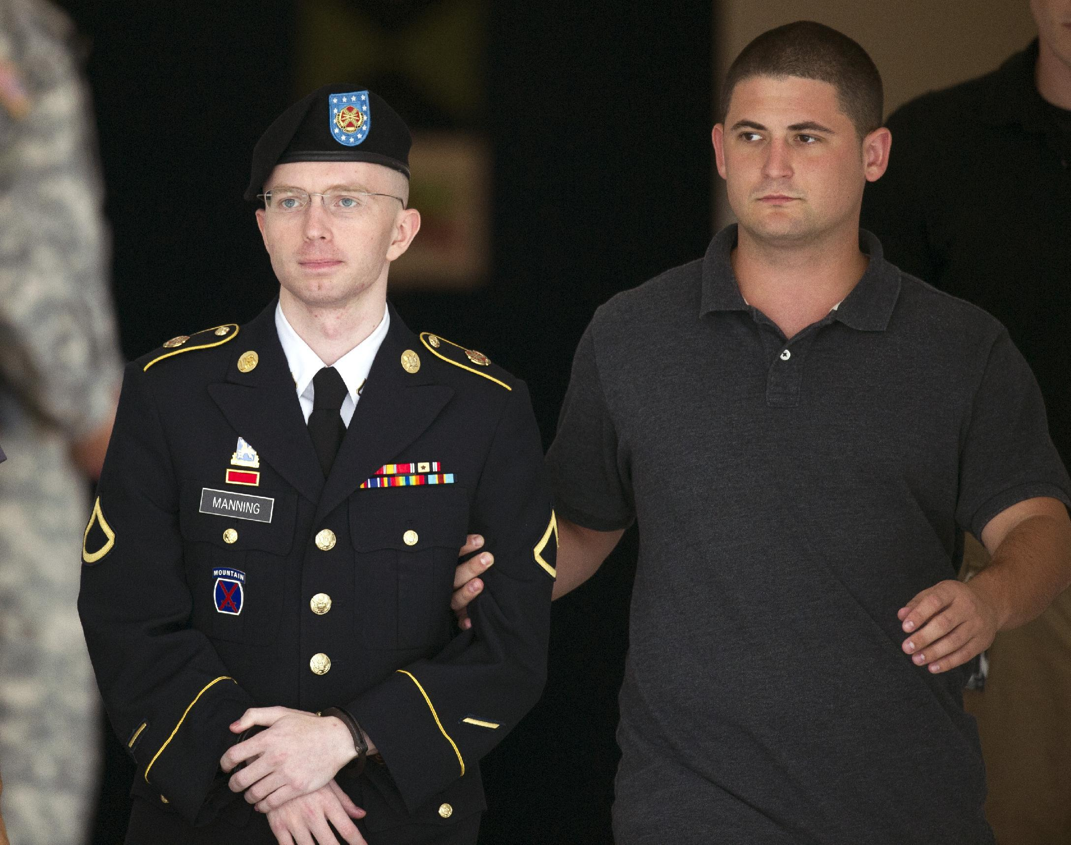 Army Pfc. Bradley Manning is escorted out of a courthouse at Fort Mead, Md, Thursday, July 25, 2013. Manning is charged with indirectly aiding the enemy by sending troves of classified material to WikiLeaks. He faces up to life in prison. (AP Photo/Cliff Owen)