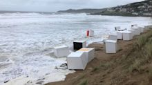 Storm Ellen: High winds blow beach huts into the sea at Woolacombe