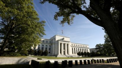 Fed at odds with itself as it eases bank rules, raises rates