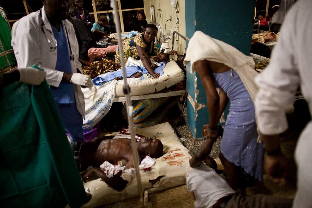 Ugandan doctors treat victims at Mulago hospital in Kampala in Kampala on July 11, 2010