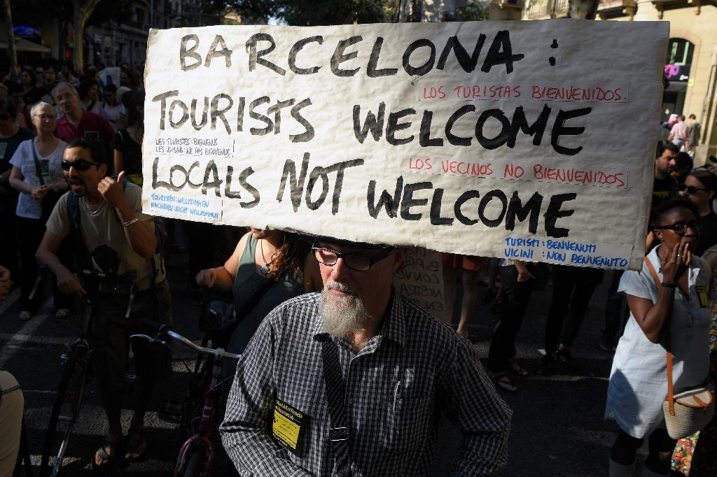 Locals in many parts of the world are angry at the rising costs and congestion that comes with hordes of tourists (AFP Photo/LLUIS GENE)