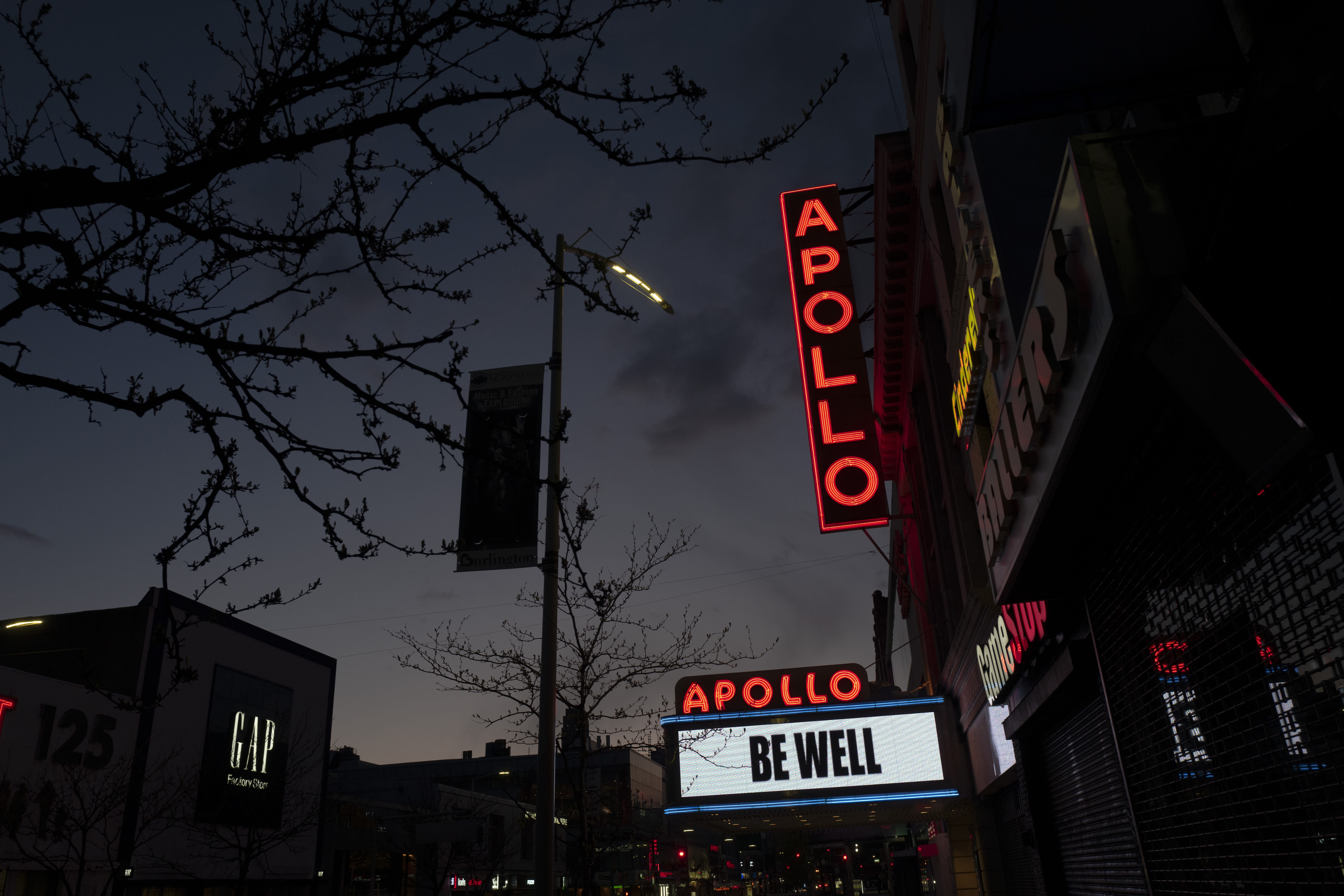"""The Apollo Theater is closed due to the coronavirus pandemic but carries the message """"Be Well,"""" Thursday, April 16, 2020, in the Harlem neighborhood of New York. Most entertainment venues nationwide are closed during the COVID-19 coronavirus pandemic. (AP Photo/Mark Lennihan)"""