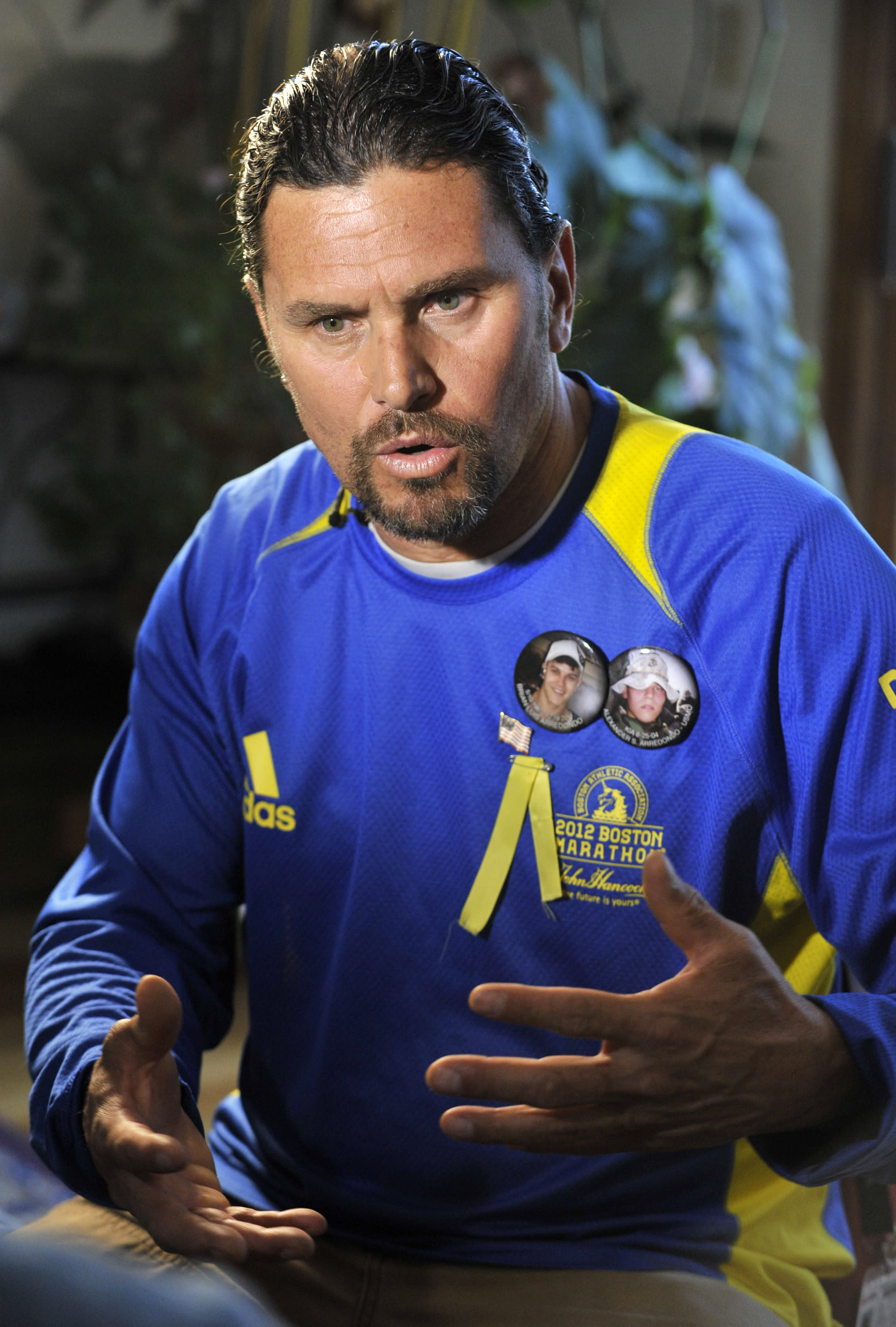 Carlos Arredondo speaks to a reporter inside his home in the Roslindale neighborhood of Boston, Wednesday, April 17, 2013. Arredondo, a peace activist whose son was killed during the Iraq war, was near the explosions and assisted victims after a pair of bombs exploded at the finish line of the Boston Marathon. (AP Photo/Josh Reynolds)