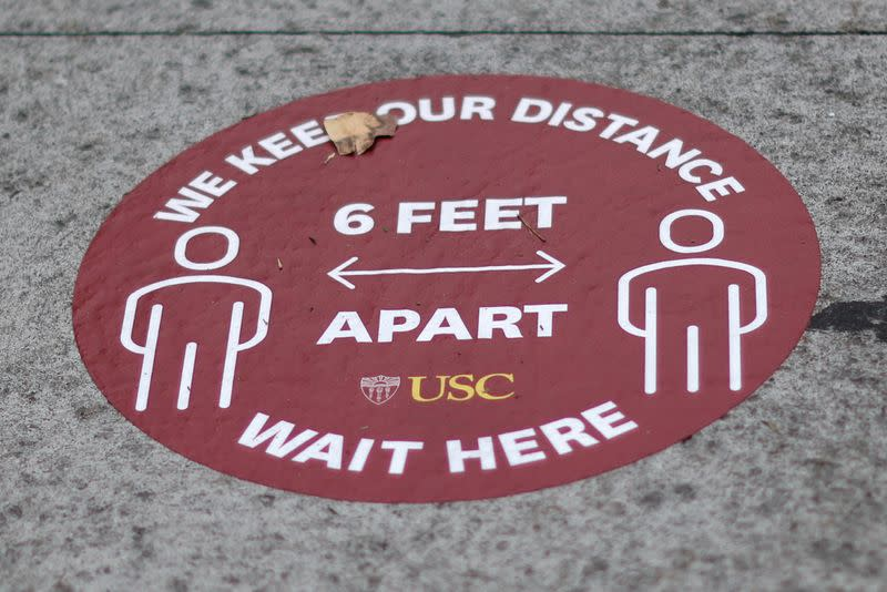 FILE PHOTO: A social distancing marker is seen on an empty University of Southern California (USC) campus, amid the outbreak of the coronavirus disease (COVID-19), in Los Angeles