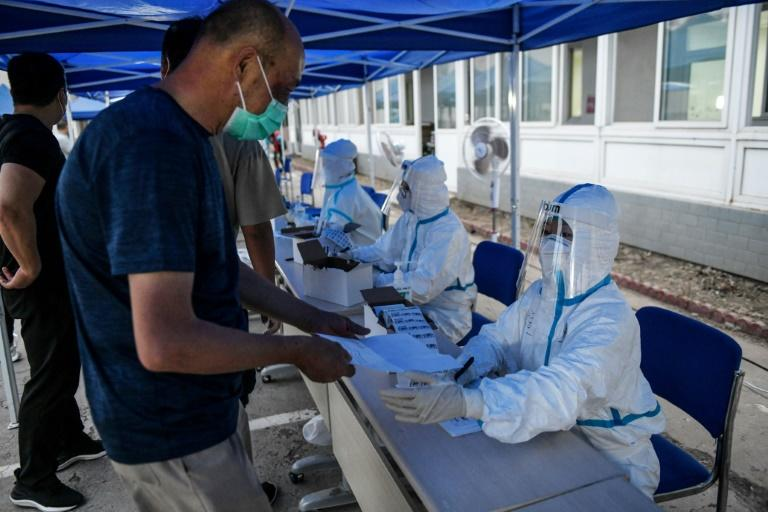 Beijing is ramping up its testing capacity as it moves to curb the new virus outbreak, and is testing thousands of people who were in or near the Xinfadi market, believed to be the source of the new cluster (AFP Photo/GREG BAKER)