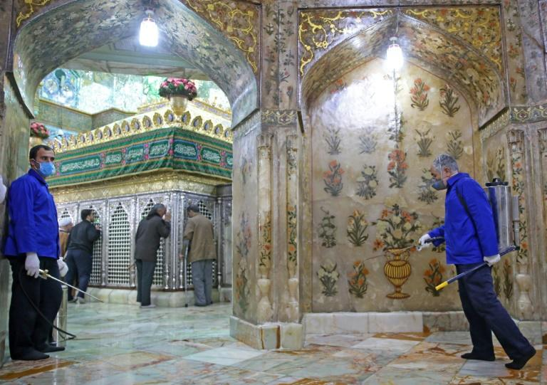 Unprotected worshippers prayed and kissed the ornate structure enclosing a tomb (AFP Photo/MEHDI MARIZAD)