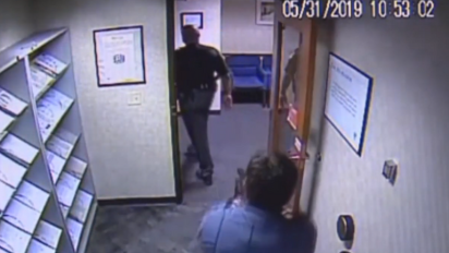 White security guard pulls gun on black police officer