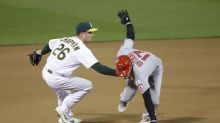 In 1st MLB game with new extra-inning rule, A's slam Angels