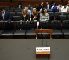 The Latest: House panel subpoenas Hicks and counsel's aide