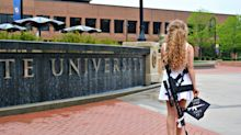 Pro-Trump college grad's assault rifle photo shoot goes viral: 'Come and take it'