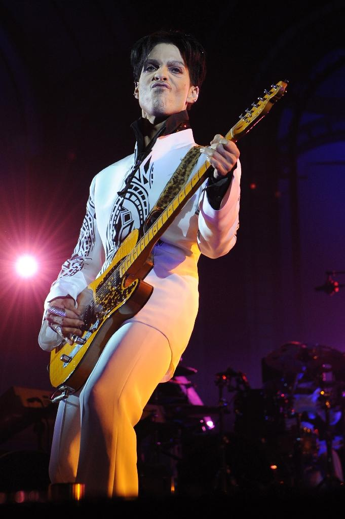 US singer Prince died from an accidental painkiller overdose on April 21, 2016 (AFP Photo/Bertrand Guay)
