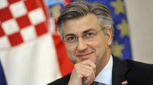 Croacia vota en reñidas elecciones marcadas por el virus