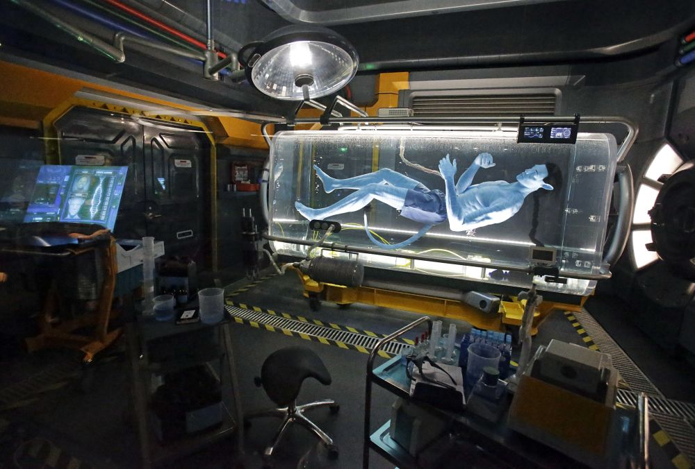 A Na'vi in a science lab is shown and will be seen while guests are in the queue for the Avatar Flight of Passage ride. (AP Photo/John Raoux)