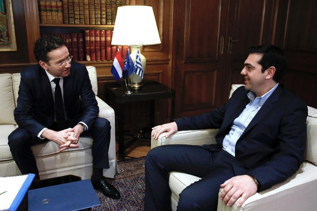 A spokesman for Eurogroup head Jeroen Dijsselbloem, seen in 2015 with Greek Prime Minister Alexis Tsipras, said the eurozone was suspending the recently announced debt relief scheme for Athens in retaliation at not being fully briefed on handout plans