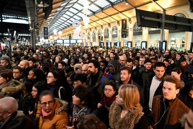 Train, metro, bus and tram transport will again hobble commuters in Paris and other big cities on Tuesday (AFP Photo/Bertrand GUAY)