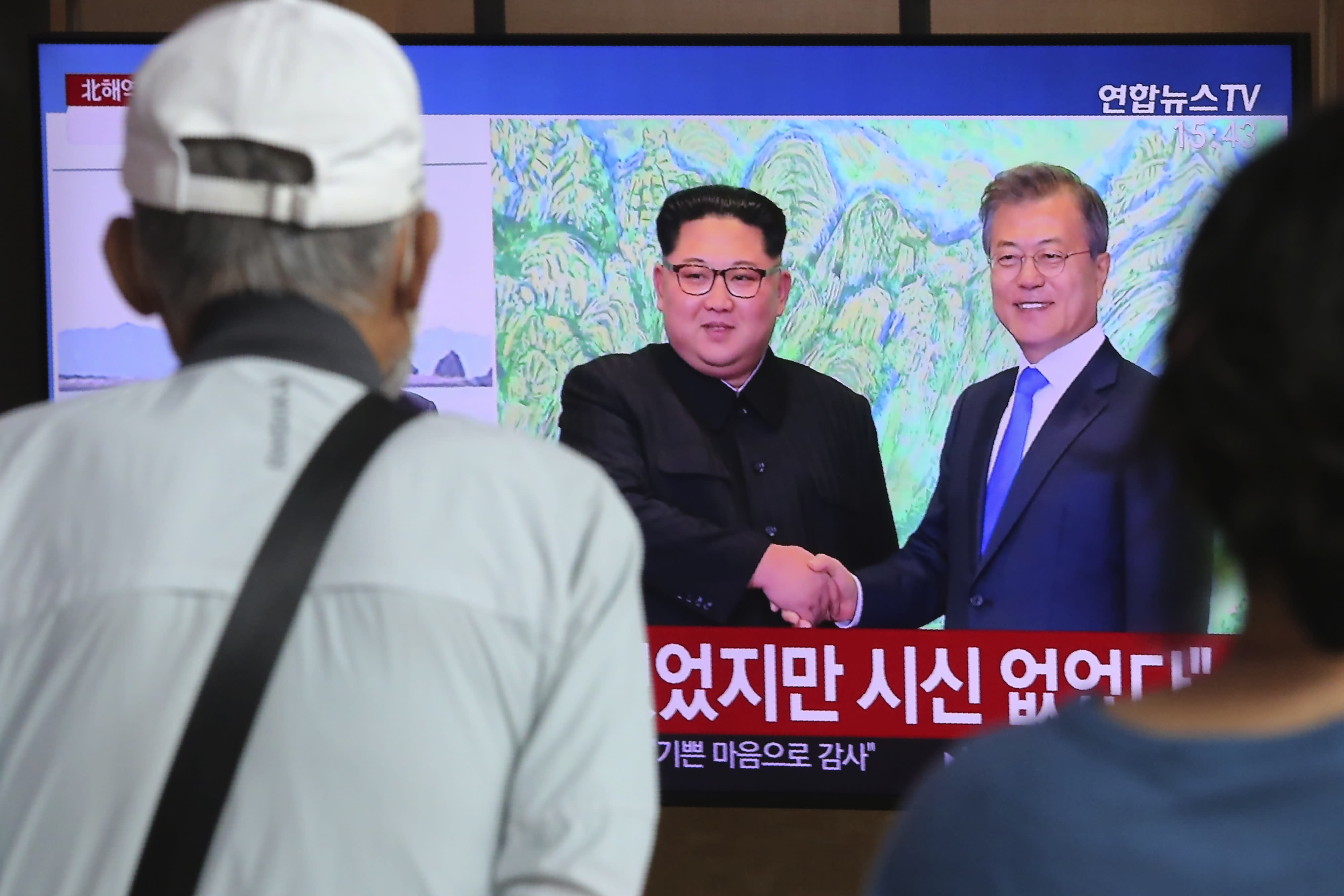 """People watch a TV showing a file image of North Korean leader Kim Jong Un, left, and South Korean President Moon Jae-in during a news program at the Seoul Railway Station in Seoul, South Korea, Friday, Sept. 25, 2020. North Korean leader Kim apologized Friday over the killing of a South Korea official near the rivals' disputed sea boundary, saying he's """"very sorry"""" about the incident he called unexpected and unfortunate, South Korean officials said. (AP Photo/Ahn Young-joon)"""