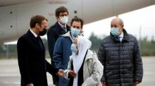 French aid worker freed by captors returns home from Mali