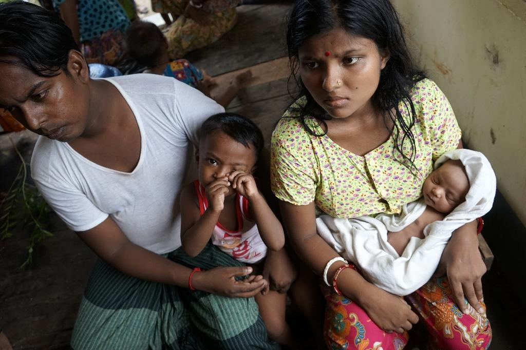 Chaw Shaw Chaw Thee (R), a 20-year-old Hindu, believes 23 members of her family are dead after Rohingya militants attacked their village in the Kha Maung Seik area of northern Rakhine (AFP Photo/Aidan JONES)
