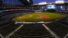 Watch: Man breaks into Brewers' ballpark, attempts to write name using tractor