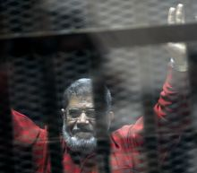 The Latest: Amnesty urges Egypt to investigate Morsi's death
