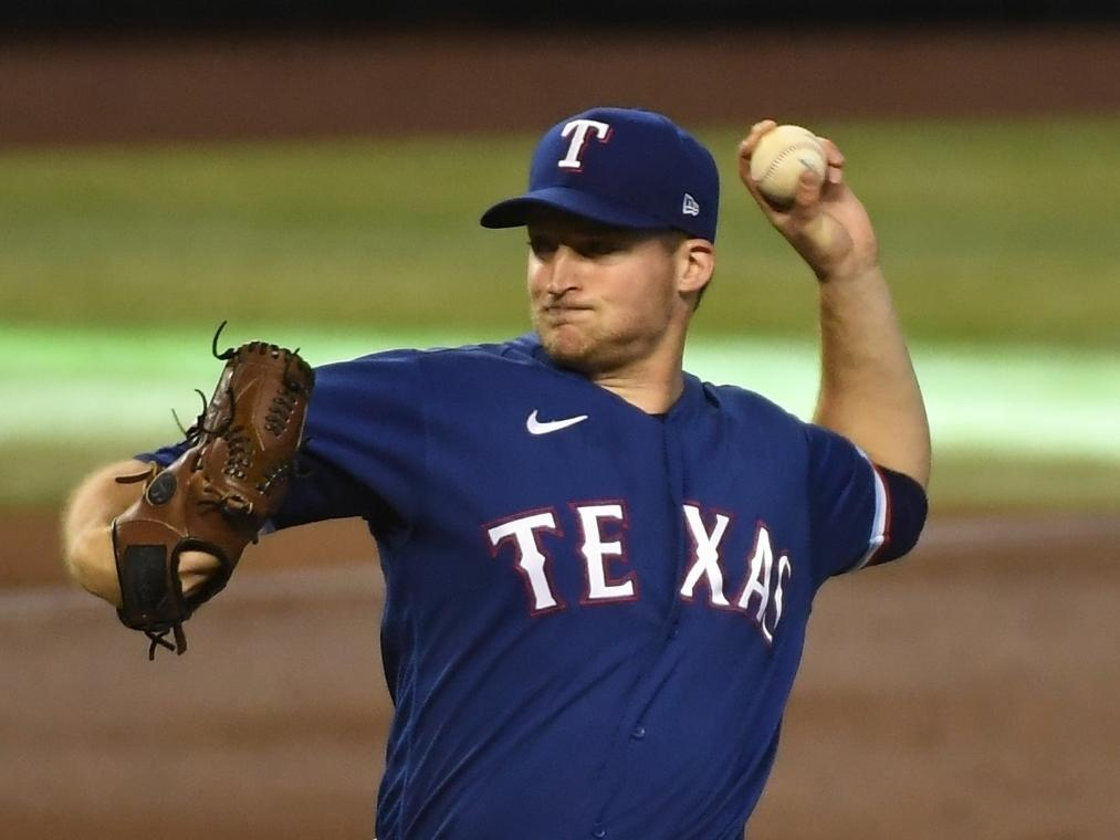Texas Rangers pitcher Wes Benjamin, who graduated from St. Charles East, throws a pitch Wednesday during his first start in Major League Baseball.