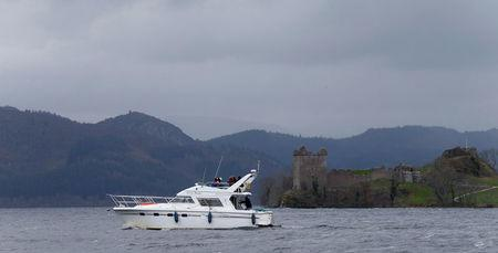 FILE PHOTO: A boat sails in front of Urquhart Castle on Loch Ness in Scotland