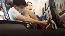 Aussie woman films man's shocking behaviour on packed flight