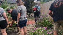 Police spend hours cleaning up cancer patient's yard, turning it into a 'virtual oasis'