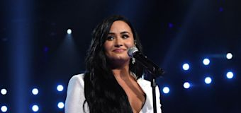Lovato restarts song after getting choked up