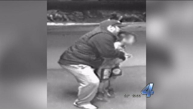 Photos Show Attempted Kidnapping Suspect Picking Up 8-Year-Old Boy