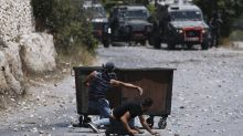 Palestinians, troops clash after funeral