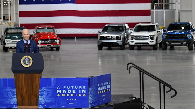 DEARBORN, MI. MAY 18, 2021 President Joe Biden spoke today at the Rouge Electric Vehicle Center in Dearborn, Mich., manufacturing home of the all-new, all-electric Ford F-150 Lightning that goes on sale in mid-2022. The F-150 Lightning will be officially revealed Wednesday, May 19, 2021, at 9:30 p.m. EDT. Pictured (left to right): Jim Farley, CEO, Ford Motor Company, Bill Ford, executive chairman, Ford Motor Company, President Joe Biden, Kumar Galhotra, president, Americas & International Markets Group for Ford Motor Company.  Photo by Sam VarnHagen.