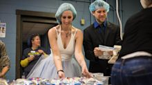 Couple weds at charity that brought them together, packs meals for hungry kids after exchanging vows