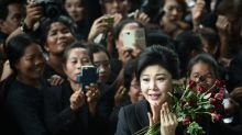 Roses, tears as Thai ex-PM Yingluck enters final stage of case