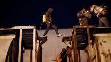 Some 50 members of migrant caravan reach Mexico, U.S. border