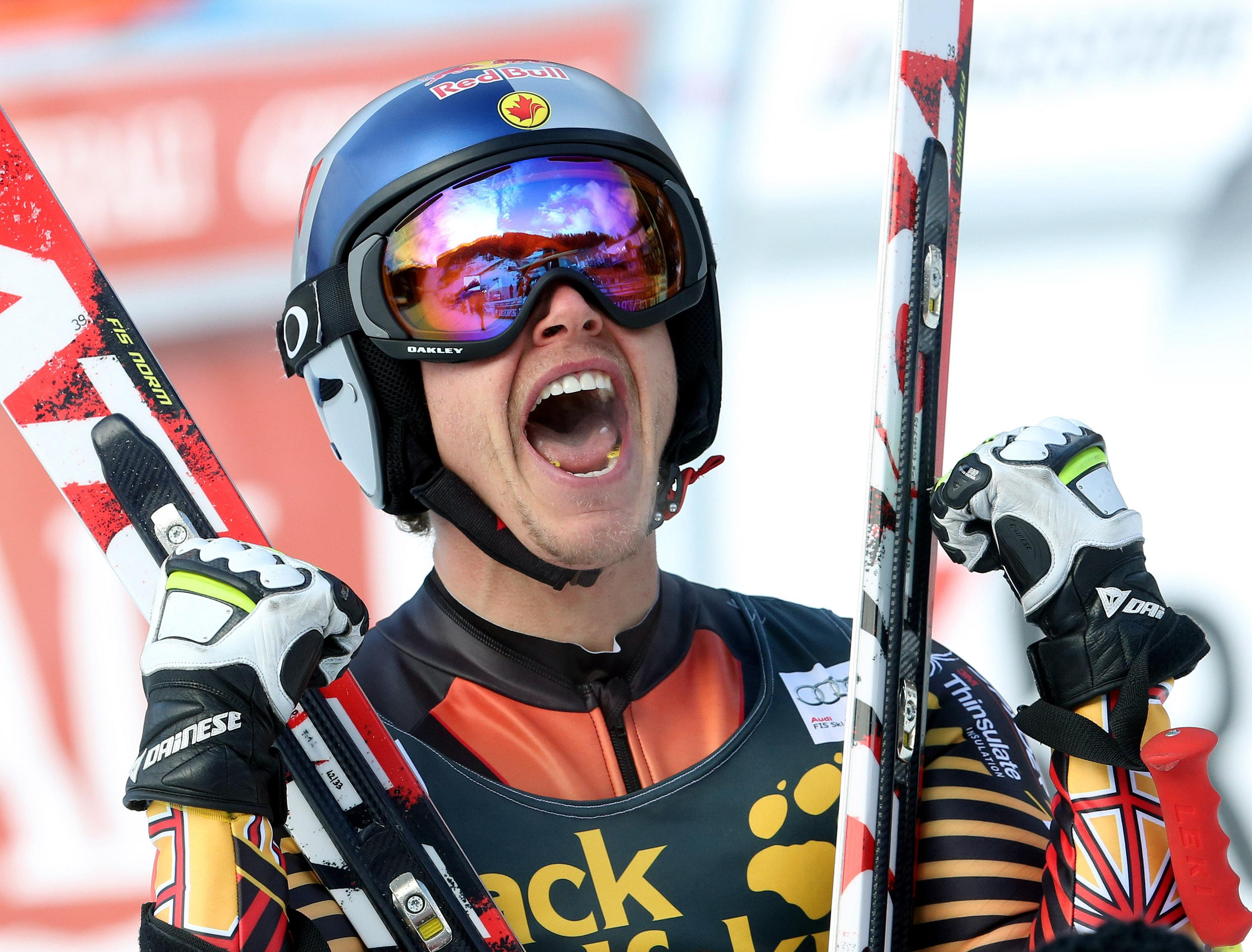 Canada's Erik Guay celebrates after winning an alpine ski, men's World Cup downhill, in Val Gardena, Italy, Saturday, Dec. 21, 2013. Canada's Erik Guay gained a measure of revenge by winning the prestigious Val Gardena downhill Saturday, a year after missing out on the victory because of changing weather. (AP Photo/Armando Trovati)