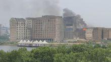 Millennium Mills fire: smoke billows from derelict building near London City Airport