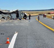 The Latest: 5 tourists still critical after deadly bus crash