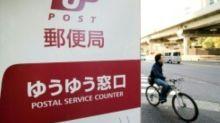 Japan raising up to $11.6 bn in postal giant share sale