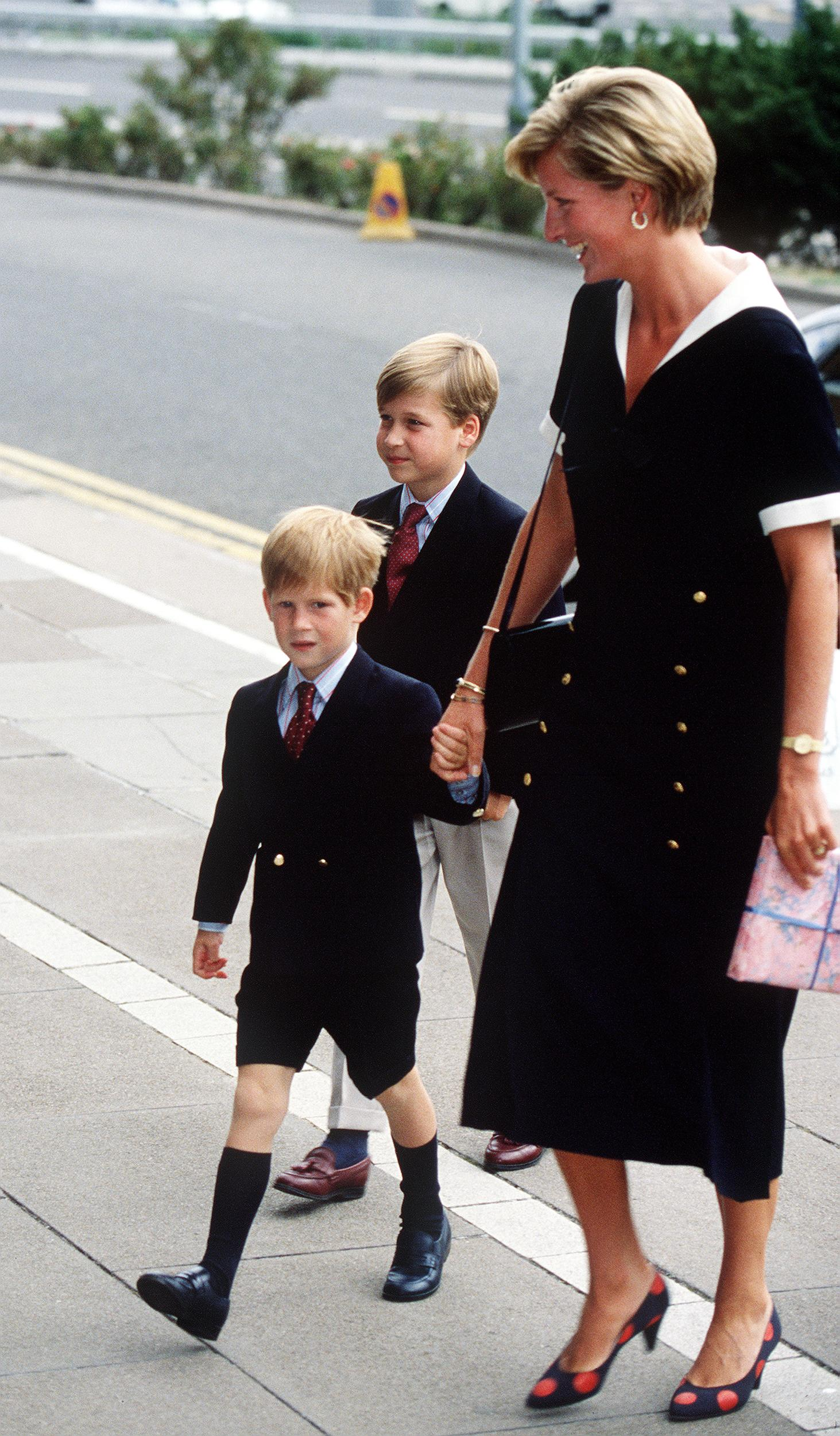 The Princess of Wales arrives at the Nottingham Medical Centre with her sons William and Harry, to visit the Prince of Wales after his operation, September 1990. She wears a black Chanel dress. (Photo by Jayne Fincher/Princess Diana Archive/Getty Images)