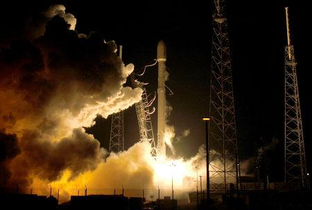 FILE PHOTO: A SpaceX Falcon 9 rocket lifts off at the Cape Canaveral Air Force Station in Cape Canaveral